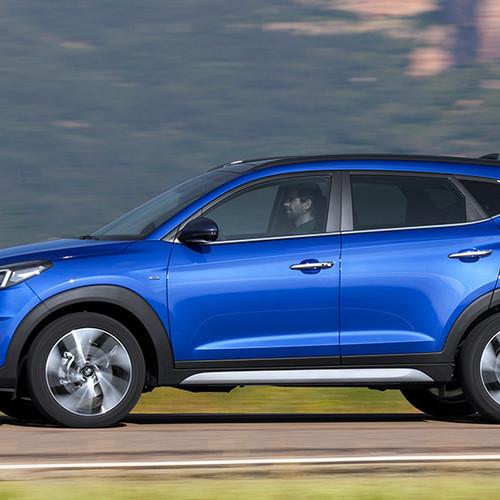 Hyundai Tucson, Seitenansicht, fahrend, blau