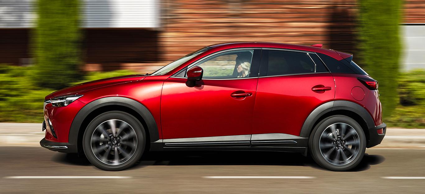 Mazda CX-3, Facelift, rot, Seitenansicht