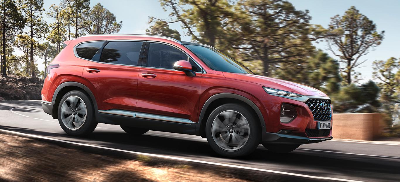 Hyundai Santa Fe, Seitenansicht, fahrend, rot