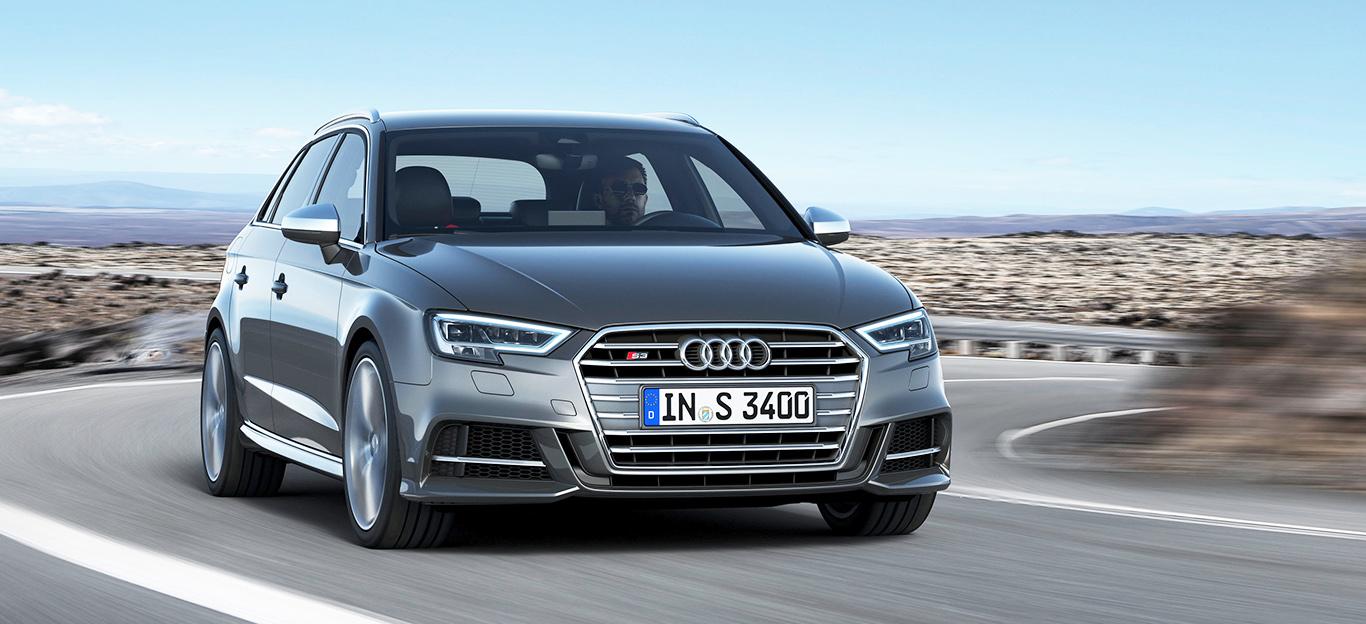 Audi S3, Halbseitenansicht von vorn, fahrend, grau