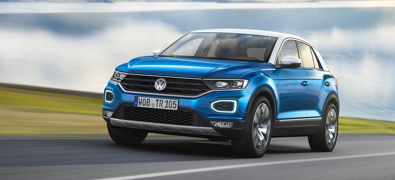 VW T-Roc, Halbseitenansicht von vorn, fahrend, blau