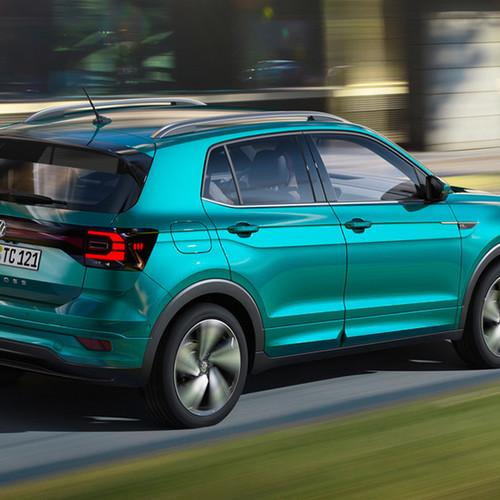 VW T-Cross, Halbseitenansicht von hinten, fahrend, grau