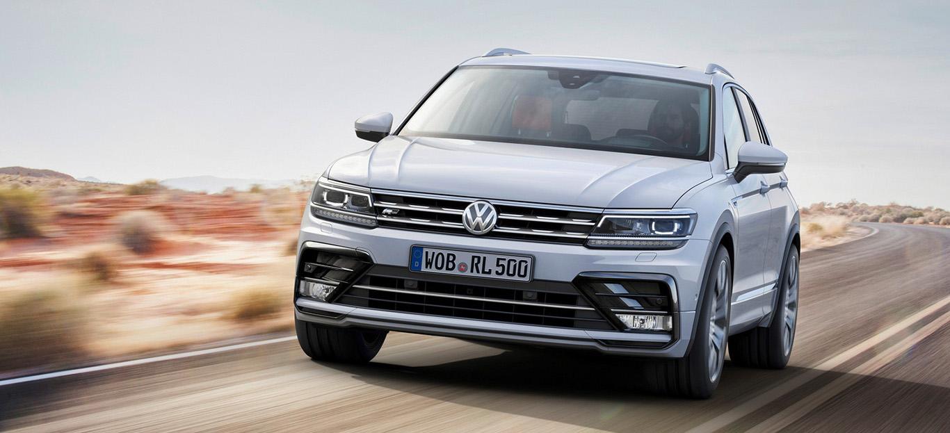 VW Tiguan, Frontansicht, fahrend, weiß