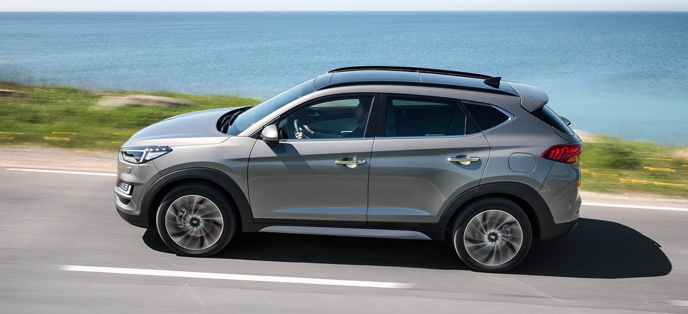 Hyundai Tucson 2018, Seitenansicht fahrend, grau
